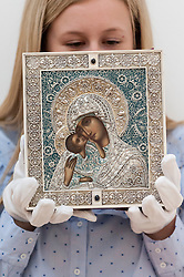 © Licensed to London News Pictures. 03/06/2016. London, UK. A staff member shows a Fabergé jewelled silver, enamel and seed-pearl icon of Pelagonitissa Mother of God, Moscow (est. GBP 20,000-30,000), at a preview of Sotheby's Russian and contemporary central and eastern European art sale which takes place in London on 7 June. Photo credit : Stephen Chung/LNP