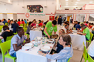 ROME, ITALY - JUNE 19: Day of Refuge, at the 'San Giovanni Paolo II' canteen in Via Marsala, the diocesan Caritas of Rome organized 'The Meal of the Meeting', with migrants and refugees to share the migratory experience. This is part of the awareness campaign 'Share the Journey' promoted by Caritas Internationalis and launched by Pope Francis on 27 September last on June 19, 2018 in Rome, Italy.