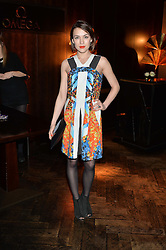 ELLA CATLIFF at the OMEGA VIP dinner hosted by Cindy Crawford and OMEGA President Mr. Stephen Urquhart held at aqua shard', Level 31, The Shard, 31 St Thomas Street, London, SE1 9RY on 10th December 2014.