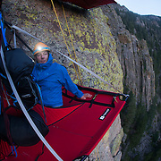 Jonathan Thompson lies on a portoledge where he spent a sleepless night 200 meters up a cliff in Estes Park,