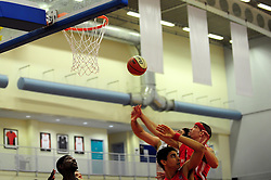 Players scramble to a rebound off the board - Photo mandatory by-line: Dougie Allward/JMP - Tel: Mobile: 07966 386802 23/03/2013 - SPORT - Basketball - WISE Basketball Arena - SGS College - Bristol -  Bristol Academy Flyers V Essex Leopards