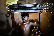 March 29, 2015 - Dhaka, Bangladesh - <br /> <br /> Made In Bangladesh<br /> <br /> Child labor still affects millions of kids worldwide.  Statistics from the International Labor Organization show that there are about 73 million children between ages 10 and 14 that work in economic activities throughout the world, and 218 million children working worldwide between the ages of 5 and 17.  These figures do not even include domestic labor.  The child labor problem is worst in Asia, where 44.6 million children have to work. In India 14.4% of all children between the ages of 10 and 14 are employed as child laborers. In Bangladesh the number is a shocking 30.1%. Bangladesh adopted the National Child Labor Elimination Policy 2010, providing a framework to eradicate all forms of child labor by 2015, but according to the International Labor Organization there are still around 3.2 million child laborers in Bangladesh and, according to the International Labour Organization, around 215 million kids worldwide are currently working in exploitative child labour conditions.<br /> <br /> It is estimated almost 5 million working children in Bangladesh. They perform in many different capacities - as domestic workers, garage helpers, factory workers, porters in railway stations and markets, workers in small foundries -- many for little or no pay, and some of them in hazardous conditions. Many boys and girls who work do not have access to education and become trapped in low-skilled, low-pay work that further binds them into the cycle of poverty. The picture is especially bleak for children living in urban slums.<br /> <br /> There is growing international recognition of the plight of working children, their poverty, vulnerabilities and deprivations. While in many countries there has been a movement for the ban on child labour, this has not always been accompanied by an analysis or understanding of the reasons for the prevalence of child labour. Also lacking is an acknowledgement of the needs of working children and their families so th