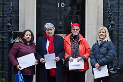 © Licensed to London News Pictures. 05/12/2016. London, UK. From left: Jessica Learmond-Criqui, Actor TOM CONTI, Linda Grove and Emily Banks deliver a petition to 10 Downing Street calling for the release of British woman Nazanin Zaghari-Ratcliffe who has been imprisoned in Iran for 150 days. Zaghari-Ratcliffe has been sentenced to five years on charges that remain secret. Photo credit: Rob Pinney/LNP