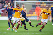 Alex Rodreguez Gorrin (#23) of Motherwell FC and Steven Naismith (#14) of Heart of Midlothian tussle for the ball during the Ladbrokes Scottish Premiership match between Motherwell FC and Heart of Midlothian FC at Fir Park, Stadium, Motherwell, Scotland on 17 February 2019.