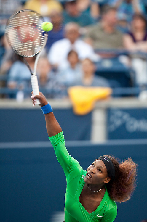 Serena Williams of the United States serves during her straight sets victory over Victoria Azarenka of Belarus in the semi-finals at the Rogers Cup WTA event in Toronto, Ontario, August 13, 2011.<br /> AFP PHOTO/Geoff Robins