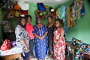 Juliet and her team (left to right) Rosa, Euphemia, Juliet, Catherine and a customer at her shop, 'Ladygold fashion'.<br /> <br /> Juliet Agu, is a designer and dress maker and runs a business called Ladygold fashion.<br /> <br /> Juliet's business is 18 years old but it has had a significant improvement in performance since her business training with Youth for Technology.<br /> <br /> One of the most significant things Juliet learnt was how to effectively manage her staff. This has really increased morale and improved their performance. <br /> <br /> She also learnt about bookkeeping for the first time in 18 years and now has an appreciation of capital investment which means she is now better able to access lucrative foreign markets.