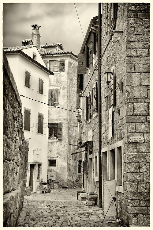 Alley in Groznjan, Istria, Croatia completed in sepia tone and HDR