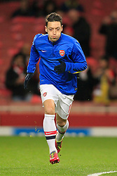 19.02.2014, Emirates Stadion, London, ENG, UEFA CL, FC Arsenal vs FC Bayern Muenchen, Achtelfinale, im Bild Mesut Oezil (Arsenal FC #11) beim Aufwaermen, Aktion, Action // during the UEFA Champions League Round of 16 match between FC Arsenal and FC Bayern Munich at the Emirates Stadion in London, Great Britain on 2014/02/19. EXPA Pictures © 2014, PhotoCredit: EXPA/ Eibner-Pressefoto/ Schueler<br /> <br /> *****ATTENTION - OUT of GER*****
