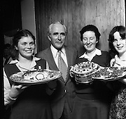 """Seafood Cook in Rosslare 07/05/197605/07/1976.7th May 1976.Pictured L-R, Siobhan Neeson, (15 years), 2nd prize, St. Louis Convent, Monaghan with her dish, """"Hot Peppered Cod"""",Mr. Tom Geoghagan, Market Development Manager, B.I.M.,Yvonne Cooney, (15 years), Dominican Convent, Muckross Park, Dublin, the winner with her dish, """"Cod Pancake Casserole"""", and Judy Tormey, (16) St. Joseph's College, Summerhill, Athlone, Co. Westmeath, 3rd prize, with her dish """"Devilled Cod"""""""