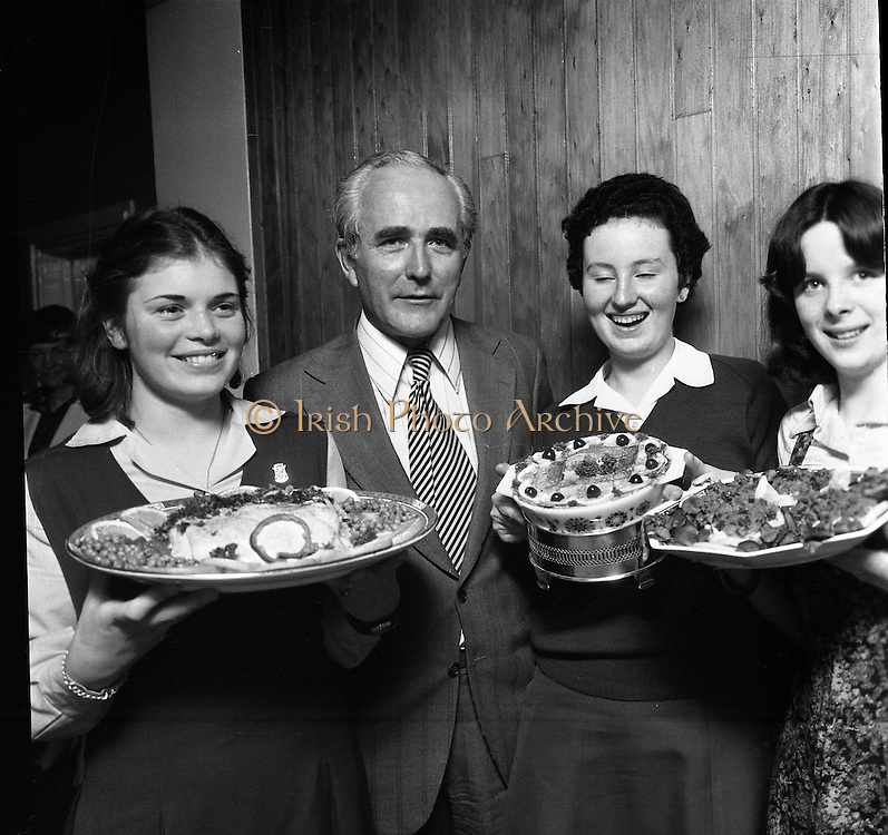 "Seafood Cook in Rosslare 07/05/197605/07/1976.7th May 1976.Pictured L-R, Siobhan Neeson, (15 years), 2nd prize, St. Louis Convent, Monaghan with her dish, ""Hot Peppered Cod"",Mr. Tom Geoghagan, Market Development Manager, B.I.M.,Yvonne Cooney, (15 years), Dominican Convent, Muckross Park, Dublin, the winner with her dish, ""Cod Pancake Casserole"", and Judy Tormey, (16) St. Joseph's College, Summerhill, Athlone, Co. Westmeath, 3rd prize, with her dish ""Devilled Cod"""