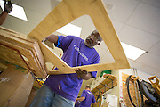 FedEx employee Cal Robinson files down the edges of a playhouse's windows to remove any splinters at the Habitat For Humanity shop in Milpitas, Calif., on Sept. 11, 2012.  Photo by Stan Olszewski/SOSKIphoto.