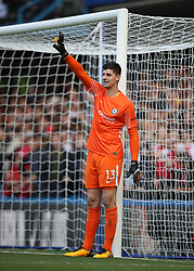 """Chelsea goalkeeper Thibaut Courtois during the Premier League match at Stamford Bridge, London. PRESS ASSOCIATION Photo. Picture date: Sunday September 17, 2017. See PA story SOCCER Chelsea. Photo credit should read: Nick Potts/PA Wire. RESTRICTIONS: EDITORIAL USE ONLY No use with unauthorised audio, video, data, fixture lists, club/league logos or """"live"""" services. Online in-match use limited to 75 images, no video emulation. No use in betting, games or single club/league/player publications."""