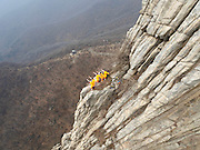 DENGFENG, CHINA - MARCH 17: (CHINA OUT) <br /> <br /> Martial Artists Practise Kung Fu On Cliffs In Dengfeng<br /> <br /> Martial artists practise kung fu on the cliffs at Mount Song on March 17, 2016 in Dengfeng, Henan Province of China. Martial art school students came onto Mount Song to do practice on Thursday. <br /> ©Exclusivepix Media