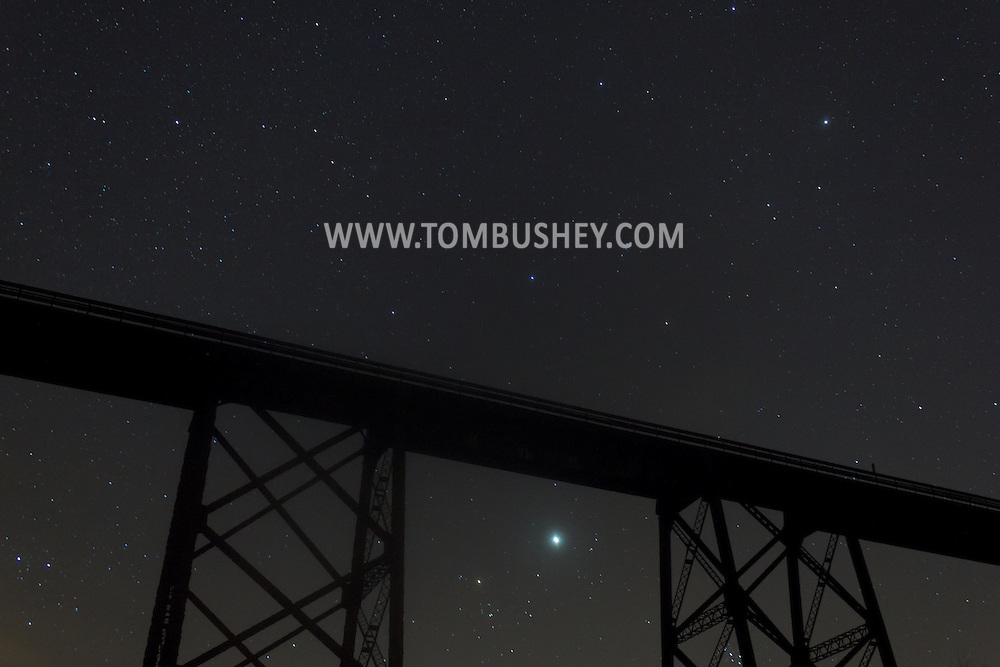 Salisbury Mills, New York - Stars in the night sky above the Moodna Viaduct railroad trestle on Dec. 14, 2012. The planet Jupiter is below the center of the trestle, above the V-shaped constellation Taurus.