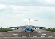 © Licensed to London News Pictures. 20/03/2012. Brize Norton, UK. The C17 Globemaster carrying the bodies comes into land at RAF Brize Norton. The repatriation of six soldiers killed in Afghanistan takes place today 20th March 2012. Sergeant Nigel Coupe, 33, of 1st Battalion The Duke of Lancaster's Regiment, Corporal Jake Hartley, 20, Private Anthony Frampton, 20, Private Christopher Kershaw, 19, Private Daniel Wade, 20, and Private Daniel Wilford, 21, all of 3rd Battalion, the Yorkshire Regiment, were killed in Afghanistan on March 6. Photo credit : Stephen SImpson/LNP