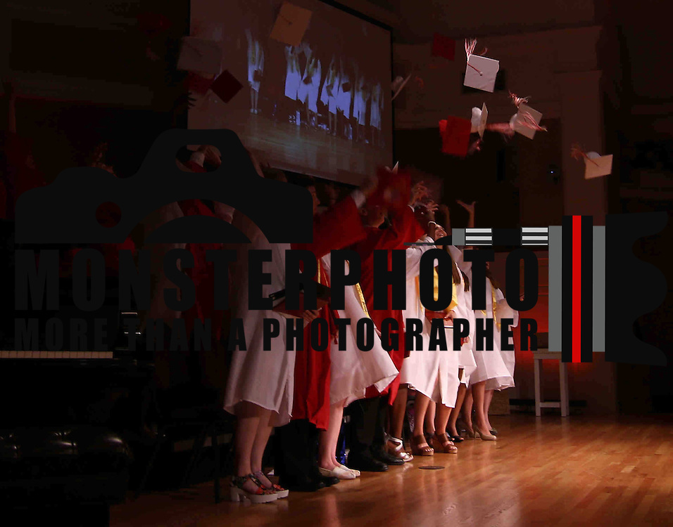 Red Lion Christian Academy student celebrate by tossing their caps into the air during commencement exercise Friday, May 29, 2015, at Glasgow Church in Bear, Delaware.