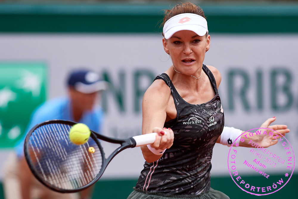 Paris, France - 2017 June 03: Agnieszka Radwanska from Poland plays a forehand during her women's single match third round  during tennis Grand Slam tournament The French Open 2017 (also called Roland Garros) at Stade Roland Garros on June 03, 2017 in Paris, France.<br /> <br /> Mandatory credit:<br /> Photo by &copy; Adam Nurkiewicz<br /> <br /> Adam Nurkiewicz declares that he has no rights to the image of people at the photographs of his authorship.<br /> <br /> Picture also available in RAW (NEF) or TIFF format on special request.<br /> <br /> Any editorial, commercial or promotional use requires written permission from the author of image.