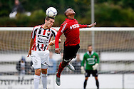 14-07-2015 VOETBAL: WILLEM II - HELMOND SPORT:TILBURG<br /> Juan Vicento van Helmond Sport (R) in duel met Dries Wuytens  van Willem II (L)<br /> <br /> Foto: Geert van Erven