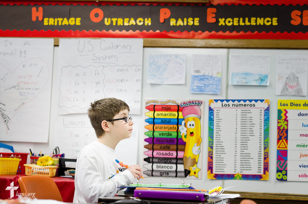 A young boy works in his class at Holy Cross Lutheran Church and School on Friday, Feb. 21, 2014, in Collinsville, Ill. LCMS Communications/Erik M. Lunsford