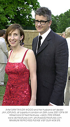 Artist SAM TAYLOR-WOOD and her husband art dealer JAY JOPLING, at a party in London on 26th June 2001.OPW 89