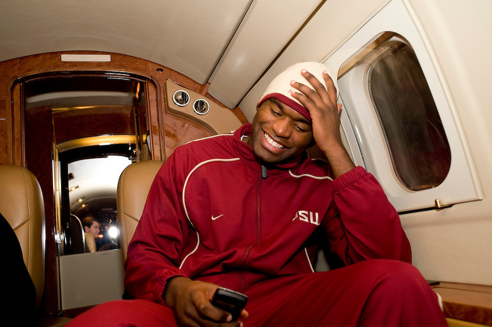 Birmingham, AL - November 22, 2008 - Florida State University football player Myron Rolle smiles while reading a text from friends offering him congratulations on receiving a Rhodes Scholarship while on the private plane taking him to an away game at the  University of Maryland.  .Photo by Susana Raab,