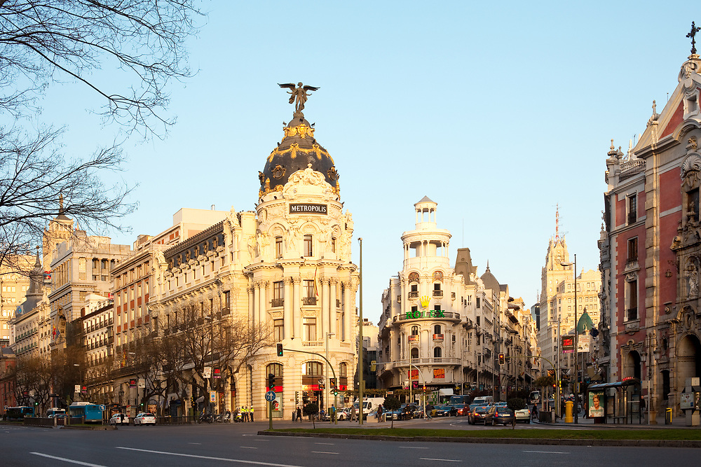 Madrid, Spain - April 5, 2010: Gran Via and the iconic Metropolis Building sourrounded by trational spanish architecture at sunrise
