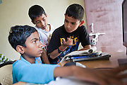 Boys in a computer lesson at the Pragya Alternate Learning Hub, Joshimath, Uttarakhand, Central Himalayas, India. The school is organised and funded by Pragya.  Pragya is a non-profit organisation providing education and information services to communities in high altitude areas of the Himalayas.