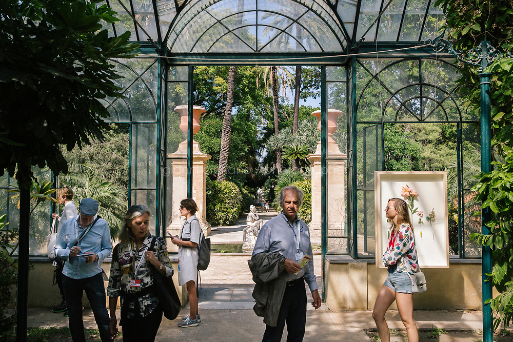 PALERMO, ITALY - 15 JUNE 2018: Artist Alberto Baraya's mixed media installation &quot;New Herbs from Palermo and Surroundings. A Sicilian Expedition&quot; (2018) is seen here in a greenhouse of the Botanical Garden during Manifesta 12, the European nomadic art biennal, in Palermo, Italy, on June 15th 2018.<br /> <br /> Manifesta is the European Nomadic Biennial, held in a different host city every two years. It is a major international art event, attracting visitors from all over the world. Manifesta was founded in Amsterdam in the early 1990s as a European biennial of contemporary art striving to enhance artistic and cultural exchanges after the end of Cold War. In the next decade, Manifesta will focus on evolving from an art exhibition into an interdisciplinary platform for social change, introducing holistic urban research and legacy-oriented programming as the core of its model.<br /> Manifesta is still run by its original founder, Dutch historian Hedwig Fijen, and managed by a permanent team of international specialists.<br /> <br /> The City of Palermo was important for Manifesta&rsquo;s selection board for its representation of two important themes that identify contemporary Europe: migration and climate change and how these issues impact our cities.
