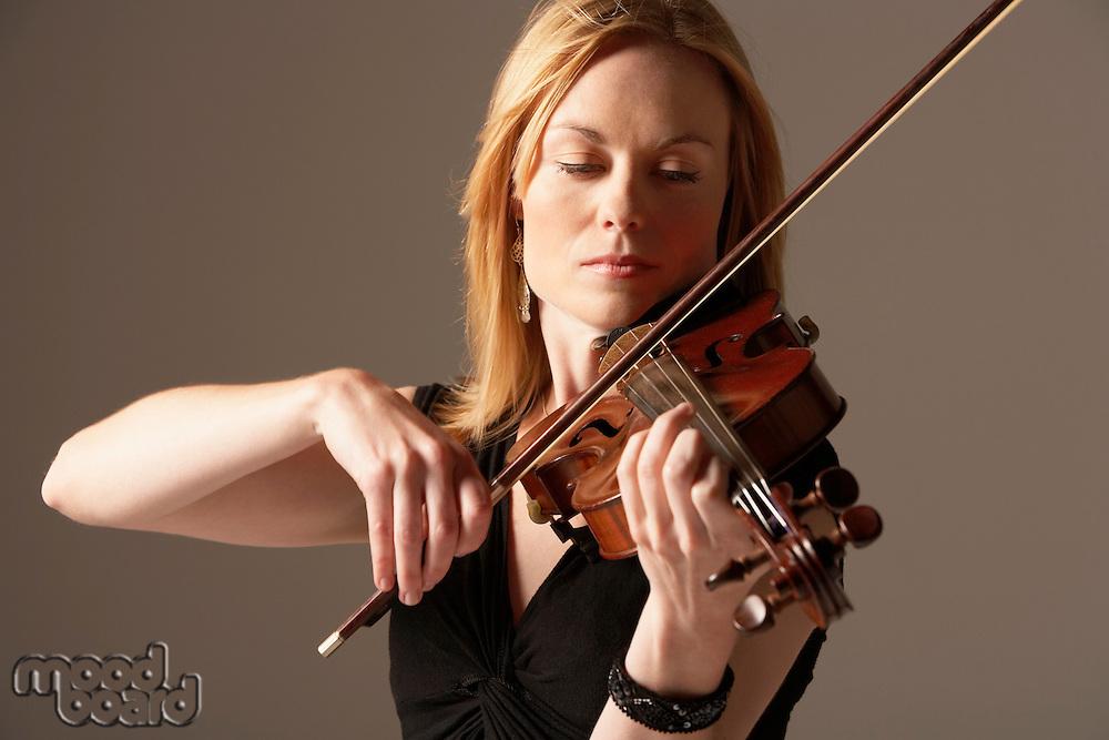 Woman Playing Violin close-up