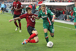 01.03.2014, SGL Arena, Augsburg, GER, 1. FBL, FC Augsburg vs Hannover 96, 23. Runde, im Bild l-r: im Zweikampf, Aktion, mit Hiroki Sakai #4 (Hannover 96), Matthias Ostrzolek #19 (FC Augsburg) // during the German Bundesliga XXth round match between FC Augsburg and Hannover 96 at the SGL Arena in Augsburg, Germany on 2014/03/01. EXPA Pictures © 2014, PhotoCredit: EXPA/ Eibner-Pressefoto/ Kolbert<br /> <br /> *****ATTENTION - OUT of GER*****