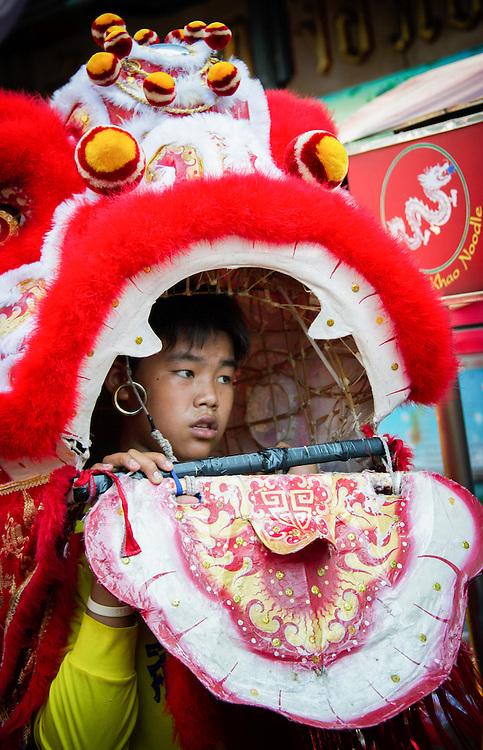 A lion dancer performs during Chinese New Year in Bangkok, Thailand