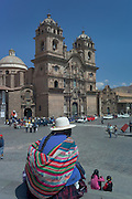 Indigenous woman sitting, Church of the Company of Jesus, Cusco, Peru
