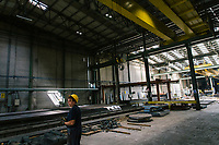 SANTA MARIA DEGLI ANGELI (ASSISI), ITALY - 11 JUNE 2018: A worker moves steel industrial parts with a magnet at the  IRON S.p.A. factory, a publicly traded company that makes industrial steel parts, in Santa Maria degli Angeli (Assisi), Italy, on June 11th 2018.<br /> <br /> President Donald Trump's administration plans to impose tariffs on European steel and aluminum imports after failing to win concessions from the European Union, a move that could provoke retaliatory tariffs and inflame trans-Atlantic trade tensions. Until the moment that the American president rendered his decision, Mr. Capponi, the commercial director of IRON spa, was confident the continent would be spared.<br /> Given that IRON is a purchaser of steel, the company might benefit from the American tariffs. Steel now shipped to the United States from mills within Europe might stay here to avoid the tariffs, raising the supply and dropping prices. Chinese producers who export to American shores could divert their product to Europe, amplifying this trend.<br /> But Mr. Capponi was banking on none of this. Even if steel prices decline, his customers are likely to squeeze him for lower prices. More broadly, the American tariffs — justified by the Trump administration as a supposed defense of national security — reverberated as a blow against world trade.