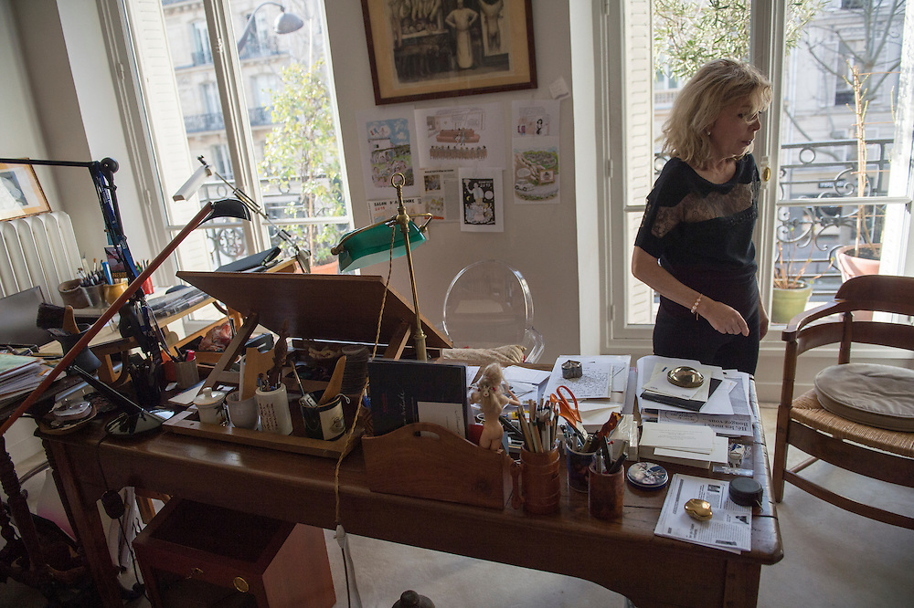 March 6, 2015, Paris, France. Writer Maryse Wolinski (1943, Algiers) in Georges Wolinski's artist studio in the Paris&rsquo; apartment where Georges and Maryse Wolinski used to live. Two month after the death of Georges Wolinski (1934 &ndash;2015), the apartment is full of souvenirs. <br /> In 2016 Maryse Wolinski published the book &ldquo;Ch&eacute;rie, je vais &agrave; Charlie&rdquo; about her husband and the attack on Charlie Hebdo. The cartoonist Georges Wolinski was 80 years old when he was murdered by the French jihadists Ch&eacute;rif en Sa&iuml;d Kouachi, he was one of the 12 victims of the massacre in the Charlie Hebdo offices on January 7, 2015 in Paris. Charlie Hebdo published caricatures of Mohammed, considered blasphemous by some Muslims. During his life, Georges Wolinski defended freedom, secularism and humour and was one of the major political cartoonists in France. The couple was married and had lived for 47 years together. Photo: Steven Wassenaar.