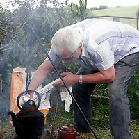 Billy McInerney was trying to get the fire going at the Spancilhill Horse Fair on Friday.<br />