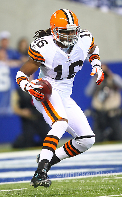 Sept. 18, 2011; Indianapolis, IN, USA; Cleveland Browns wide receiver Josh Cribbs (16) runs the kickoff return at Lucas Oil Stadium. Cleveland defeated Indianapolis 27-19. Mandatory credit: Michael Hickey-US PRESSWIRE