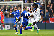 Watford forward, on loan from Milan, M'Baye Niang (21) battles with Leicester City defender Danny Simpson (17)  and Leicester City midfielder Marc Albrighton (11) during the Premier League match between Leicester City and Watford at the King Power Stadium, Leicester, England on 6 May 2017. Photo by Jon Hobley.