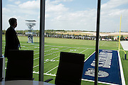 "Frisco ISD Superintendent Dr. Jeremy Lyon looks out over the Cowboys practice fields from a conference room in the new Dallas Cowboys headquarters in Frisco, Texas on August 23, 2016. ""CREDIT: Cooper Neill for The Wall Street Journal""<br /> TX HS Football sponsorships"
