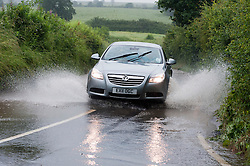 Torrential  rain causes flooding on Wentworth Lane near the Junction of Scholes Lane between Wentworth and Thorpe Hesley Sheffield..6 July 2012.Image © Paul David Drabble