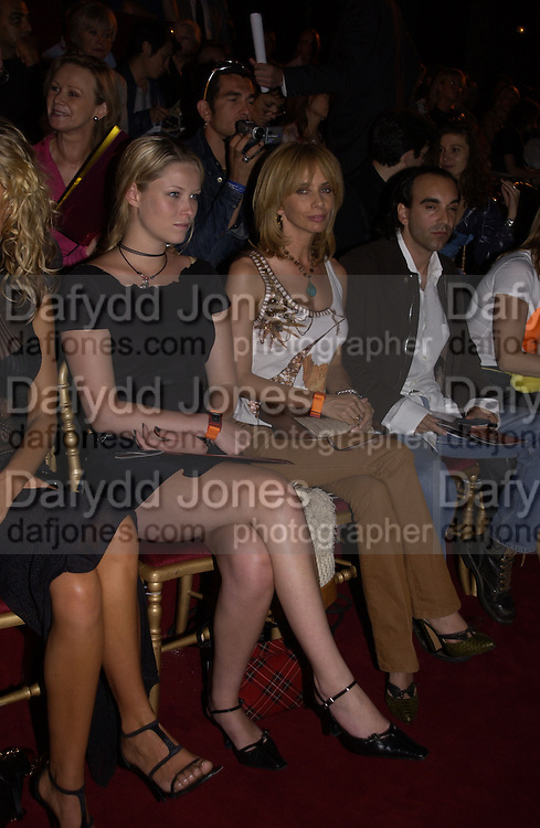Kiera Chaplin and Rosanna Arquette. Christian Dior couture show. Ecole Nationale Superiore des Beaux- Arts. Paris. 7 July 2001. © Copyright Photograph by Dafydd Jones 66 Stockwell Park Rd. London SW9 0DA Tel 020 7733 0108 www.dafjones.com