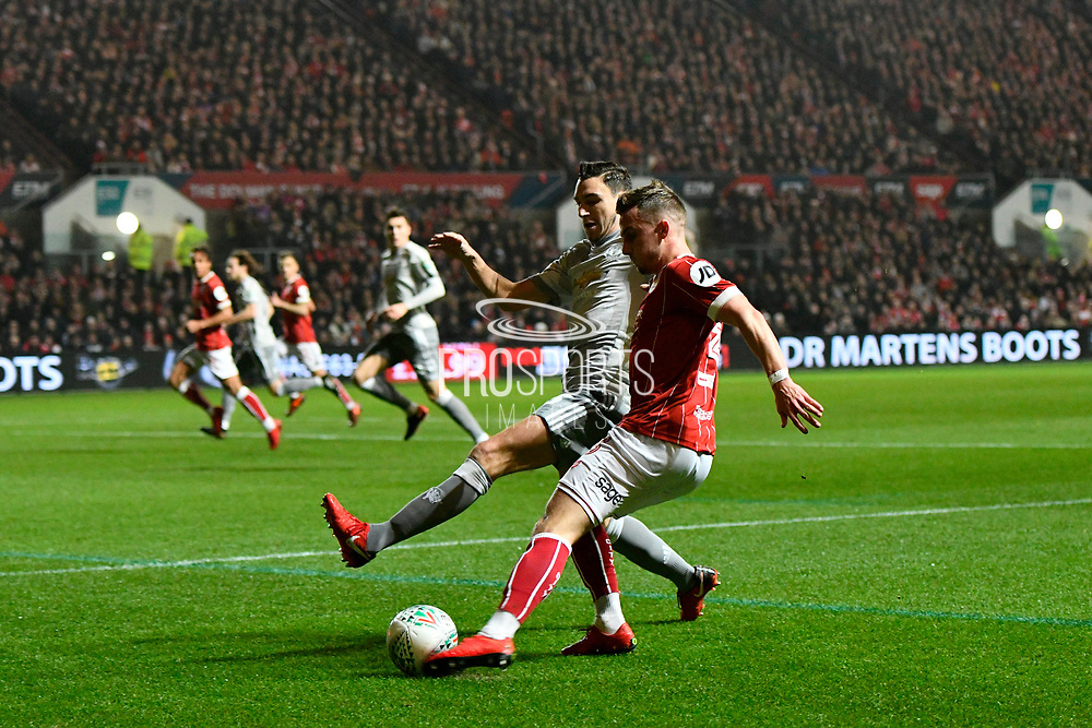 Joe Bryan (3) of Bristol City crosses the ball under pressure from Matteo Darmian (36) of Manchester United during the EFL Cup match between Bristol City and Manchester United at Ashton Gate, Bristol, England on 20 December 2017. Photo by Graham Hunt.