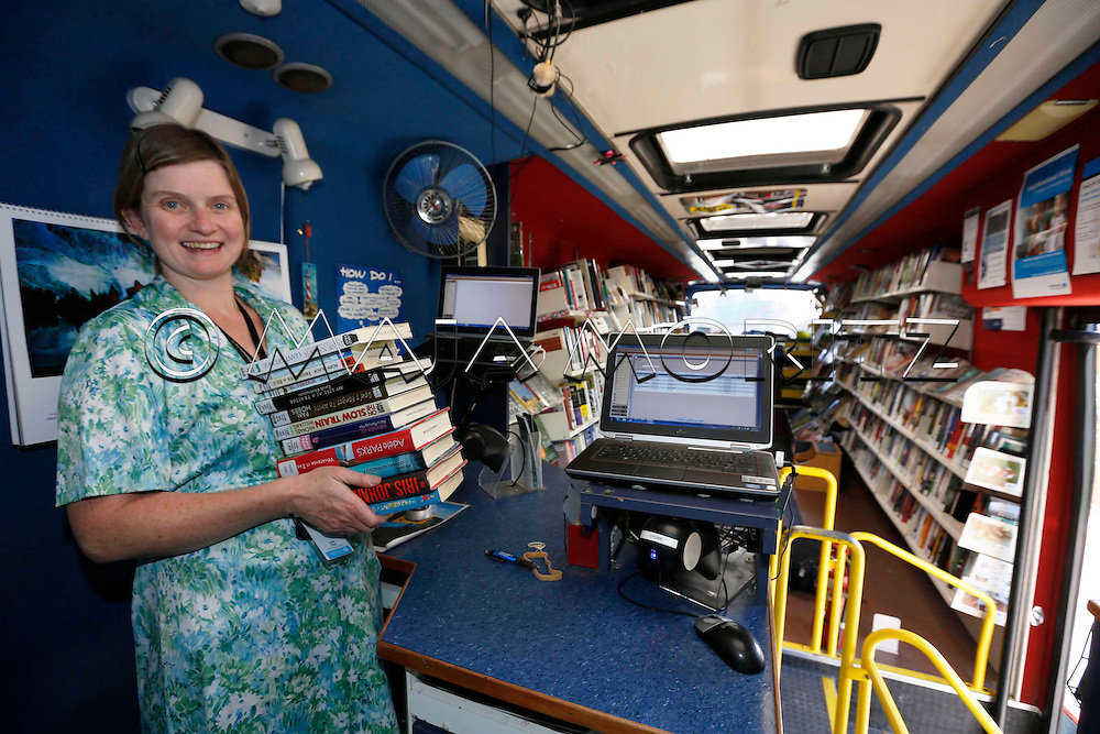 Sarah Pope drives the bus and looks after the books and all other needs of this mobile library in Christchurch, New Zealand, Christchurch has only this one bus running as a mobile library