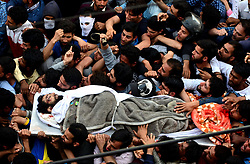 May 5, 2018 - Srinagar, Kashmir, India - Kashmiri Muslims shout anti-india and pro-independence slogans while carrying the body of Fayaz Ahmad a rebel who was killed during a gunfight in Chattabal area. (Credit Image: © Sanna Irshad Mattoo via ZUMA Wire)