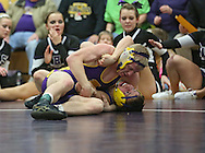 Alburnett's Colton Martin (top) tries to pin Wilton's Zach Keppy during the 138-pound bout in the Class 1A Wrestling Regional between Alburnett and Wilton at Alburnett High School in Alburnett on Tuesday, February 5, 2013. Martin defeated Keppy with a technical fall. (Stephen Mally/Freelance)