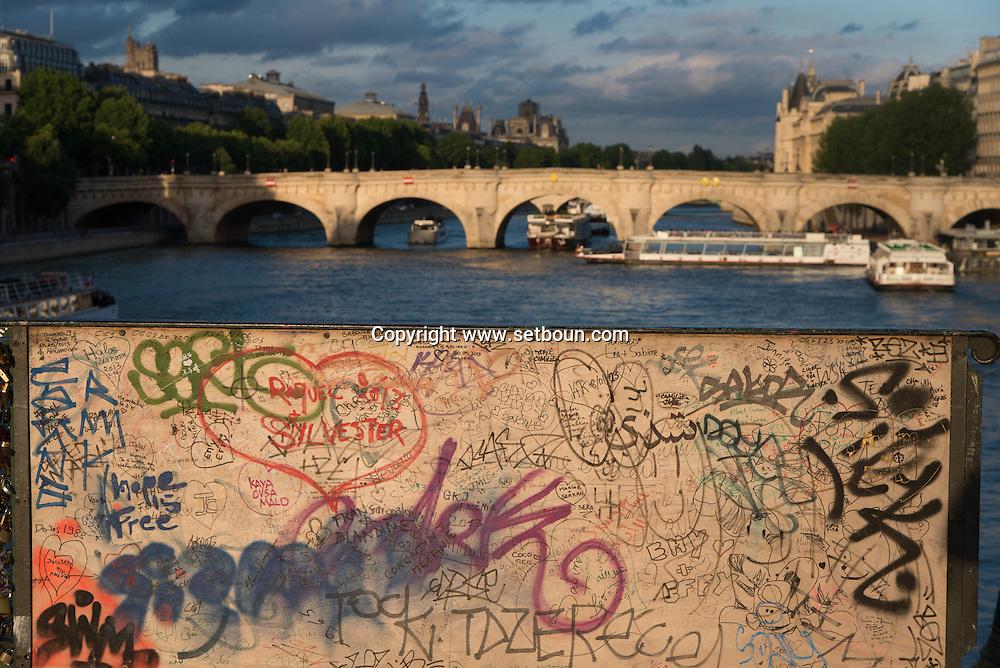 France. Paris.1st district. mural art on the pont des Arts on the Seine river / la passerelle des arts sur la Seine