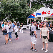 August 25, 2016, New Haven, Connecticut: <br /> Fans shop at the pro shop during Day 7 of the 2016 Connecticut Open at the Yale University Tennis Center on Thursday, August  25, 2016 in New Haven, Connecticut. <br /> (Photo by Billie Weiss/Connecticut Open)