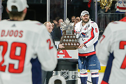 June 7, 2018: NHL Commissioner, Gary Bettman, awards Conn Smythe Trophy to Washington Capitals left wing Alex Ovechkin (8) after the Washington Capitals and Vegas Golden Knights NHL Stanley Cup Final playoff game 5 at T-Mobile Arena in Las Vegas, NV. John Crouch/CSM
