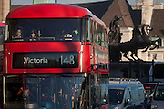 Commuters on a number 148 London bus to Victoria station travels through Westminster, passing the statue of Iceni tribe leader Boudicca, on 18th January 2017, in Parliament Square, London England.