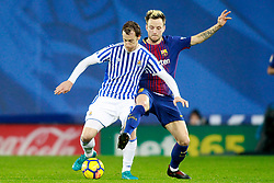 Real Sociedad's David Zurutuza (l) and FC Barcelona's Ivan Rakitic during La Liga Real Sociedad v FC Barcelona match in San Sebastian-Donostia, Spain, January 14, 2018. Photo by Acero/AlterPhotos/ABACAPRESS.COM