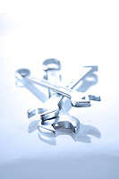 Close-up of wrenches on white background